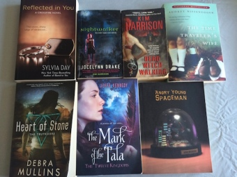Pictures of books in giveaway: Reflected in You, Nightwalker, Dead Witch Walking, The Mark of the Tala, Angry Young Spaceman, Heart of Stone, The Time Traveler's Wife